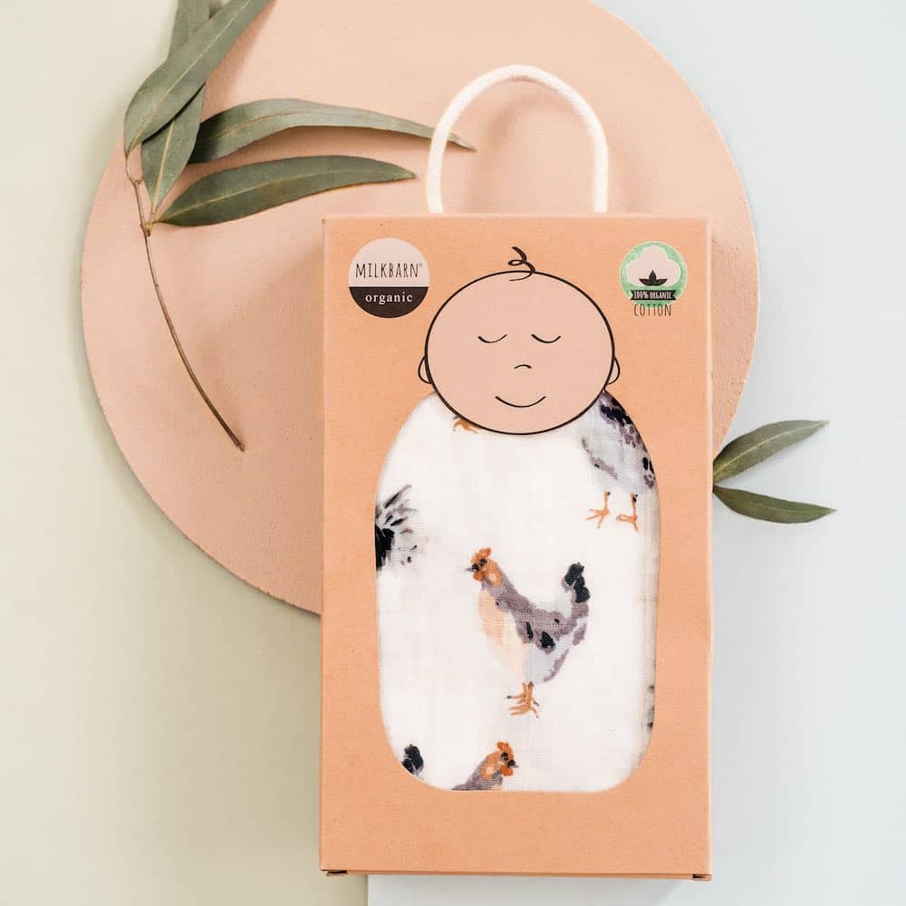 Packaging display of the Milkbarn Kids Organic baby and newborn Swaddle