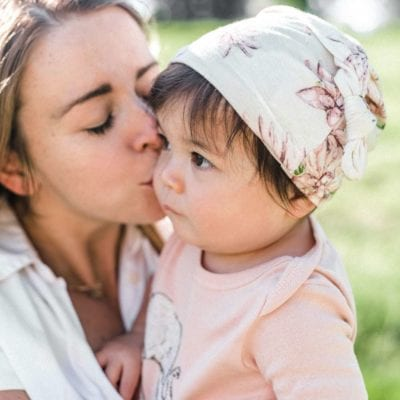 Mom and Little Baby Girl Wearing the Bamboo Knotted Hat in the Water Lily Print by Milkbarn Kids