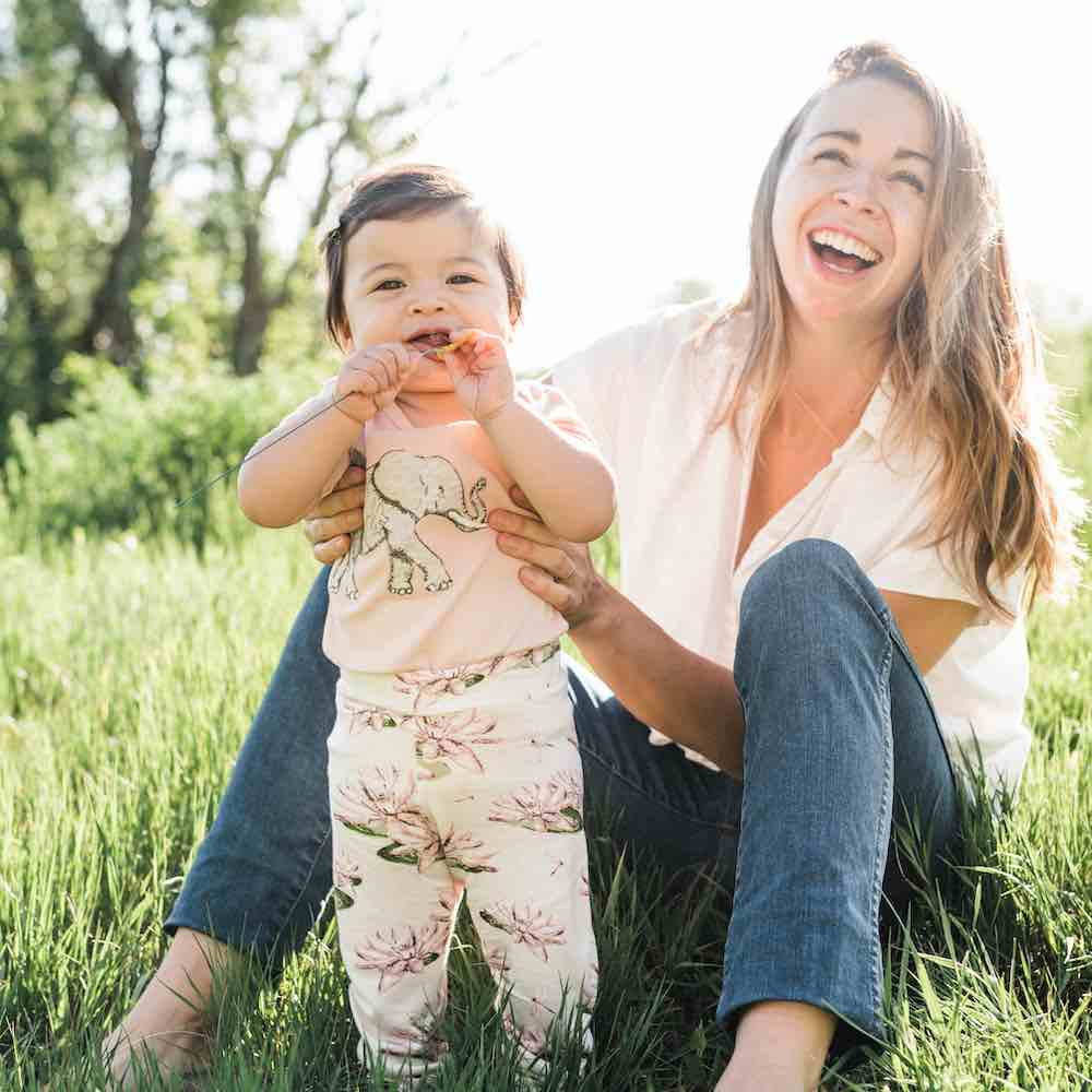 Mom and Little Baby Girl Wearing Bamboo Leggings in the Water Lily Print and the Organic Cotton Applique One Piece in the Tutu Elephant by Milkbarn Kids