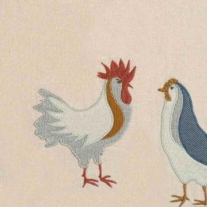 Milkbarn Kids Applique Detail of the Chicken Applique on the Organic Linen Bibs