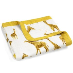 Folded Big Lovey Blanket in the Orange Giraffe Print by Milkbarn Kids