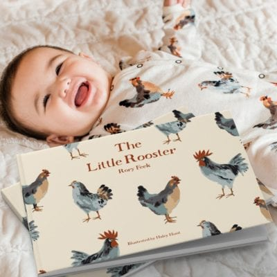 The Little Rooster by Rory Feek with Baby Wearing Matching Organic Cotton Chicken Print Footed Romper by Milkbarn Kids