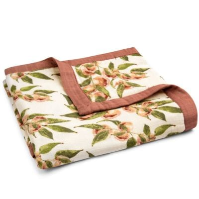 Big Lovey Muslin Blanket in the Peaches Print by Milkbarn Kids Folded