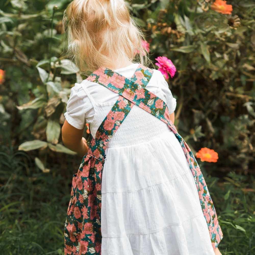Little Girl in a Garden in a Pinafore Apron by Milkbarn Kids Back Detail