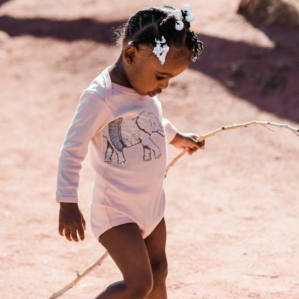 Little Girl with a stick walking in the Tutu Elephant Applique Long Sleeve One Piece by Milkbarn Kids